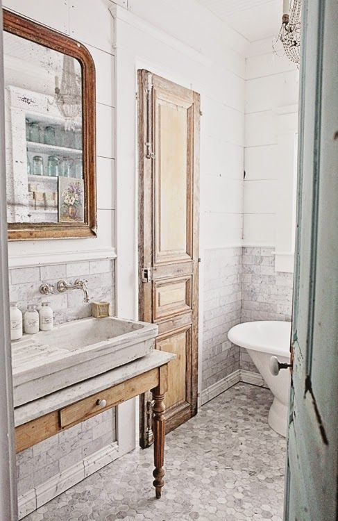 French Inspired Bathroom Remodel Carrera Marble Subway Tile Hex And A Stone Sink