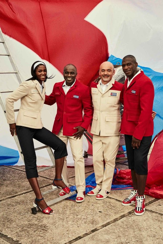 6c79f40e35b Members of the Cuban national team pose with Henri Tai and Christian  Louboutin in the official nonperformance outfit for the 2016 Olympic Games   ...
