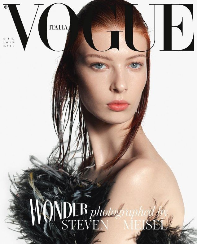 84f46f1e3 The 20-year-old wears a black feathered Giorgio Armani Privé dress in the  simplistic cover shot styled by Joe McKenna.