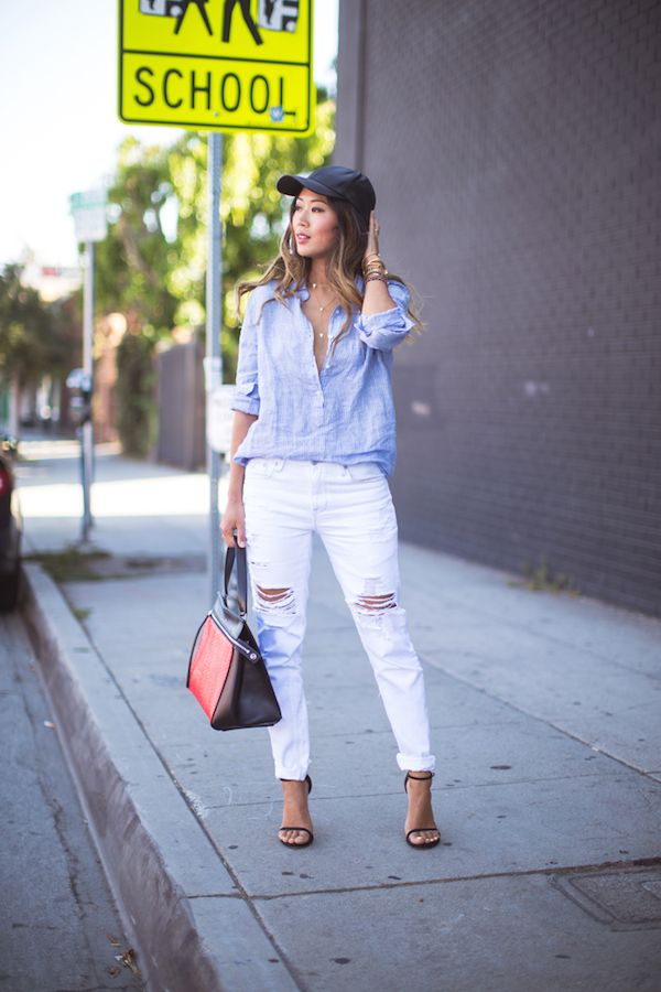 071be8ce594 Aimee of Song of Style paired a striped J.Crew shirt with ripped jeans and  a red infused Céline bag.
