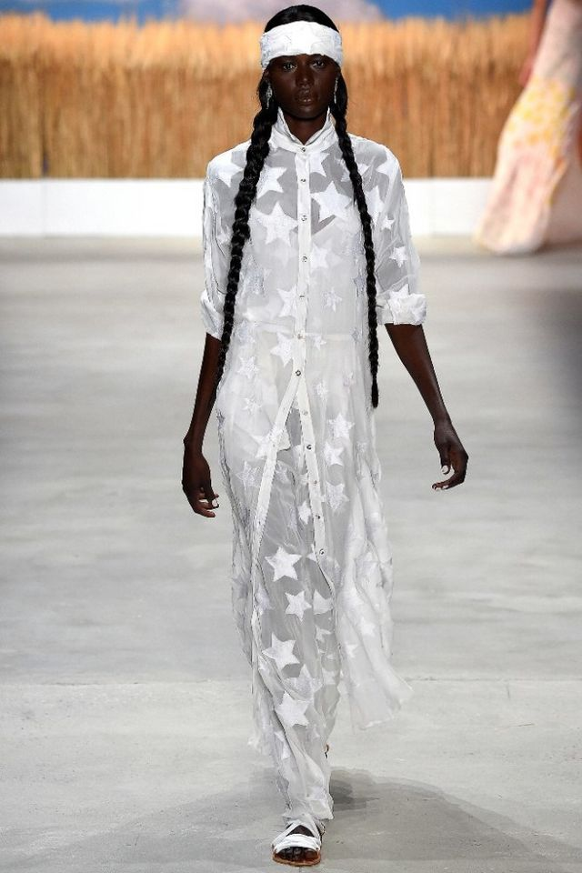 3c2ca1612139 The opening looks also echoed the sentiment: a menswear-inspired suit,  button-front shirt, wide headband, and strappy sandals wrapped in clouds.