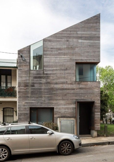 Stirling house is a sydney home clad with rough timber for Architecture firms in australia