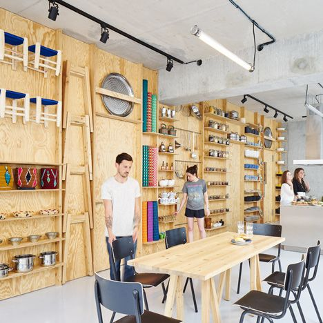 Tools and furniture hook onto a plywood wall in paris for Chair design workshop