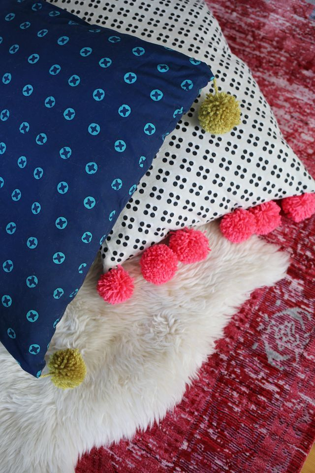 pom pom oversized floor pillow tutorial a beautiful mess bloglovin. Black Bedroom Furniture Sets. Home Design Ideas