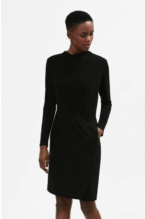 This style is the Akiko. The pencil skirt bottom is wool and the slightly draped top is crepe. And it's my favorite. I own it in three colors.