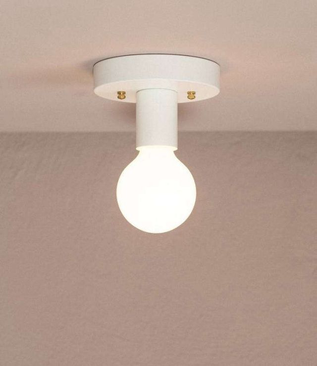 Above the ofs flush mount light fixture is a simple ceiling light thats both designed and made in vancouver 74 95 bulb not included
