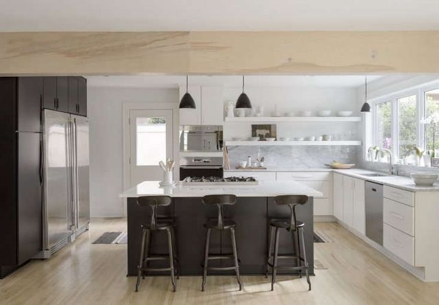 Above Izabella And Brandon Worked With A Local Kitchen Design Store On The Black White Cabinets Was Their Own Red Oak Hardwood Floors