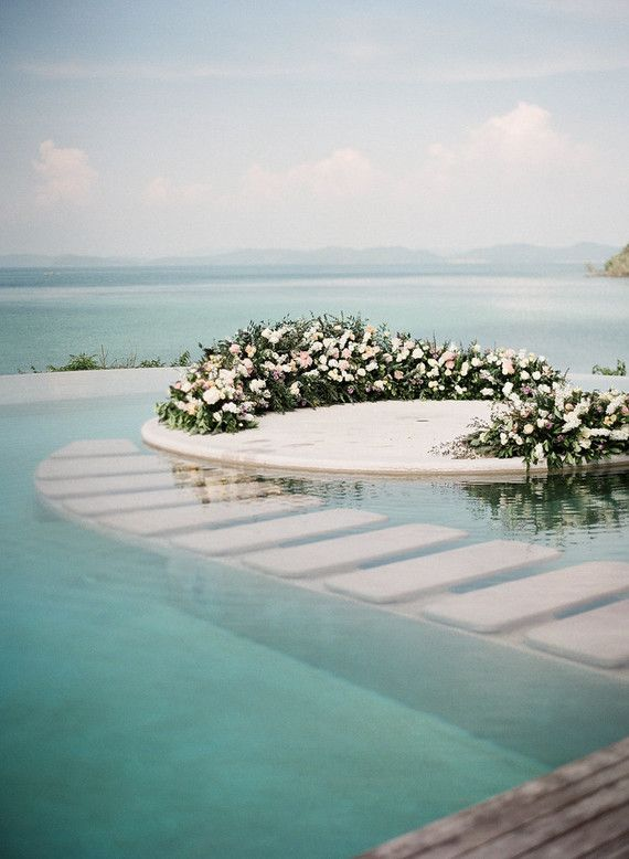 ... floral wreath full of blooms from I Am Flower floating on water at The  Naka Island in Phuket, Thailand. And boy did they pull it off!