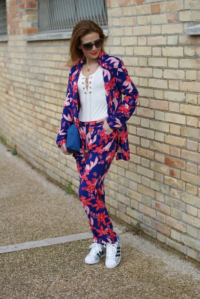 Moschino sunglasses Yerse pyjama suit Lookbook Store lace up bodysuit Zara  clutch Adidas Superstar sneakers