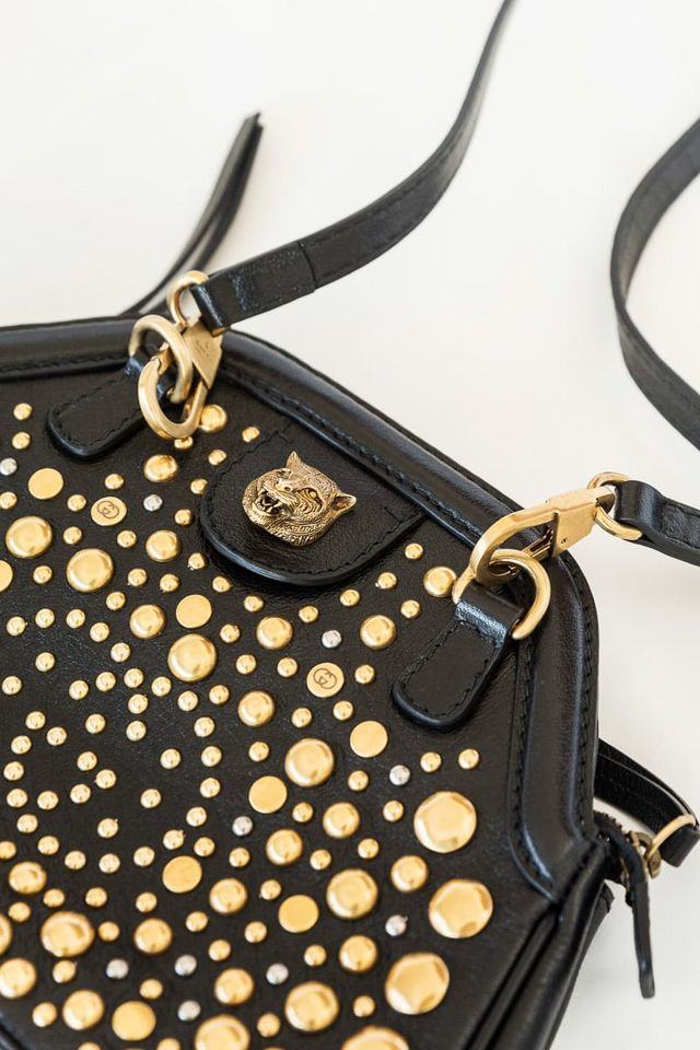 0852f2e368f ... Gucci Small RE(BELLE) Crossbody Bag. This studded little lady shines in  black leather with gold detailing