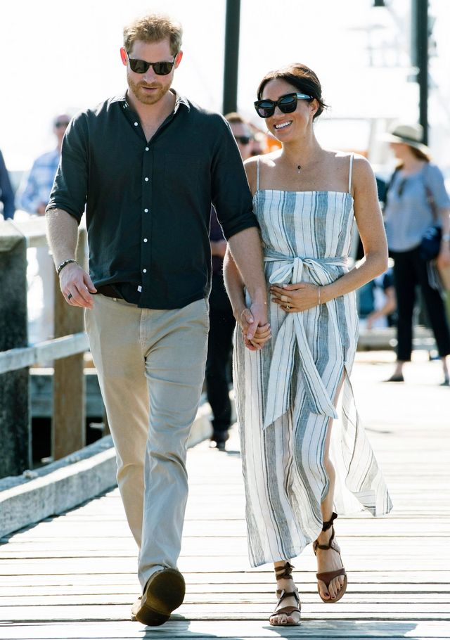 7e17e9402fbc The Duchess of Sussex styled her sandals with a Reformation dress and Karen  Walker sunglasses