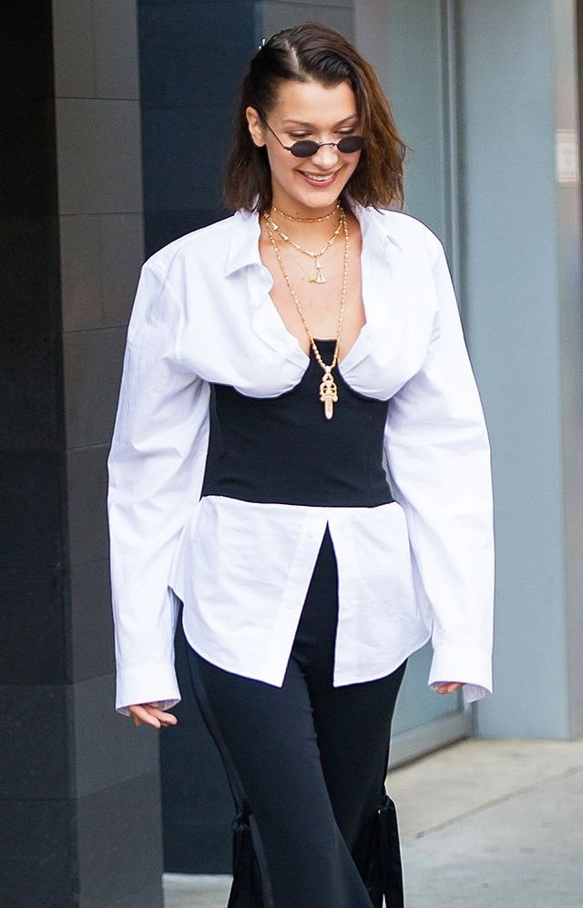5dbf8477a9552 On Bella Hadid  Orseund Iris Structured Corset ( 230)  Givenchy Trousers  With Detached Satin Band ( 462)  Roberi   Fraud Doris Sunglasses ( 195).